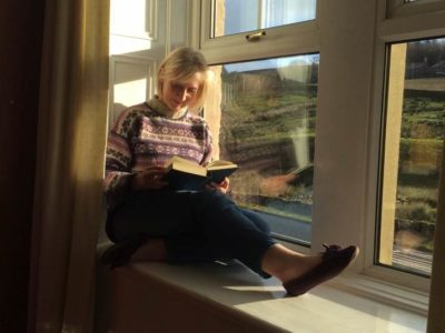 A guest reading a book at The Garsdale Retreat